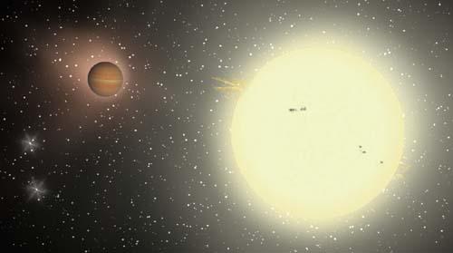 (Simulación por ordenador del planeta TrES-4, junto a su estrella.) (Foto: Jeffrey Hall, Lowell Observatory)